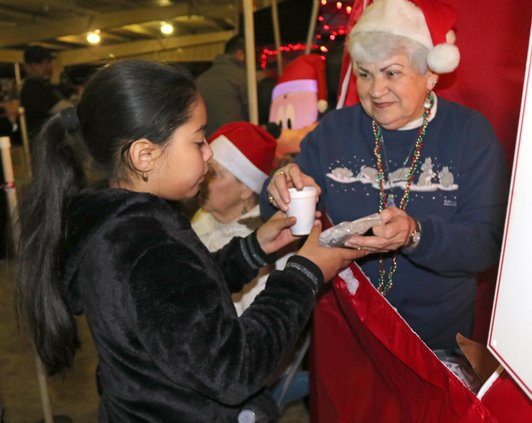 Betty Khan hands out cookies.jpg